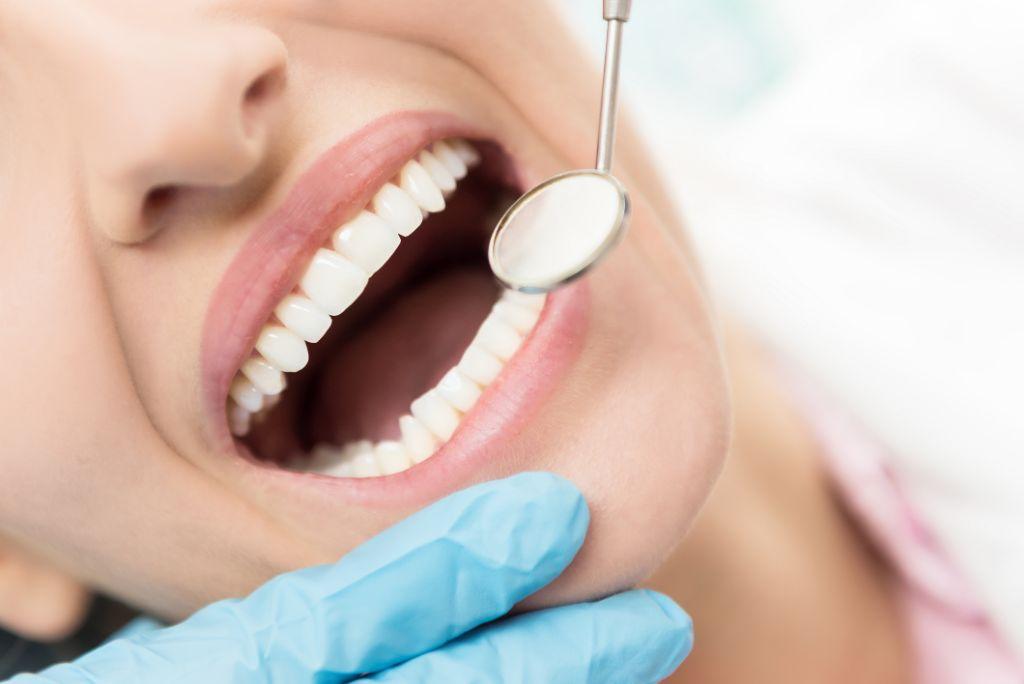 Horizontal close-up image of woman having dental examination.